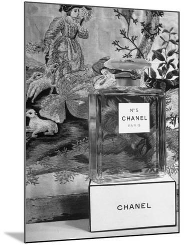 Close Up of Perfume Bottle-Hans Wild-Mounted Photographic Print