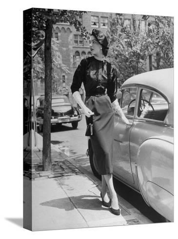 Katherine Cassidy Wearing a Red Fraostmann Wool Skirt and Black Sweater Beneath Black Cardigan-Nina Leen-Stretched Canvas Print