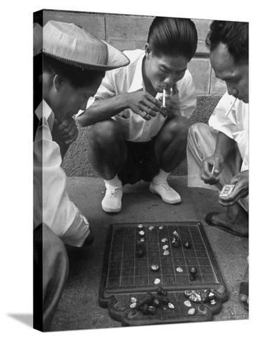 Boys Playing Board Game on Sidewalk in Front of the Trocadero Hotel-Dmitri Kessel-Stretched Canvas Print