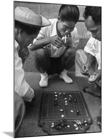 Boys Playing Board Game on Sidewalk in Front of the Trocadero Hotel-Dmitri Kessel-Mounted Photographic Print