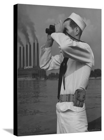 Coast Guard Patrolling Mississippi River Opposite East Saint Louis Power Plant-Alfred Eisenstaedt-Stretched Canvas Print