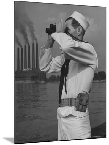 Coast Guard Patrolling Mississippi River Opposite East Saint Louis Power Plant-Alfred Eisenstaedt-Mounted Photographic Print