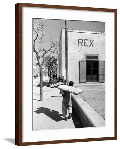 Baker's Apprentice Carrying a Large Tray of Bread Dough-Alfred Eisenstaedt-Framed Art Print