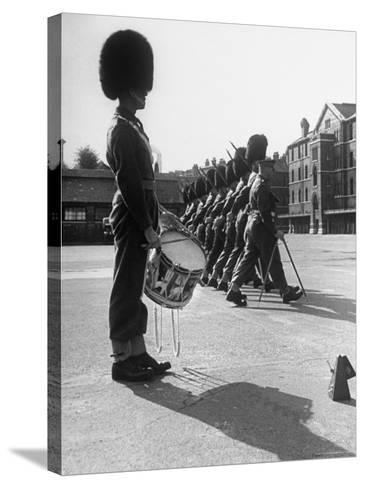 Drummer Beating in Time with Metronome-Cornell Capa-Stretched Canvas Print