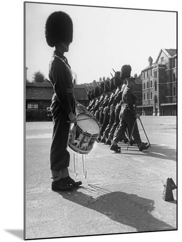 Drummer Beating in Time with Metronome-Cornell Capa-Mounted Photographic Print