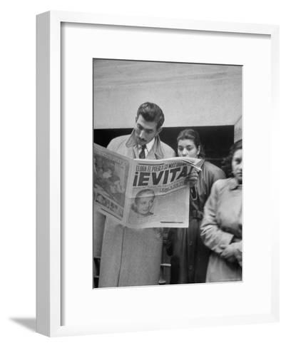 Couple Reading Newspaper Account of the Death of Evita Peron at 33 from Cancer-Alfred Eisenstaedt-Framed Art Print