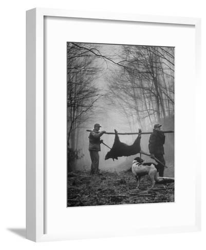 Jim Atchley and Dr. Ray Atchley Carrying Boar That They Killed-Ralph Crane-Framed Art Print