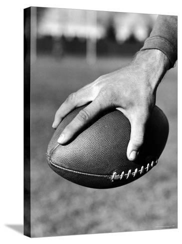 Holding the Football is Player Paul Dekker of Michigan State-Joe Scherschel-Stretched Canvas Print