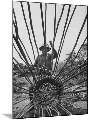 Man Making a New Trap For Fishing-Dmitri Kessel-Mounted Photographic Print