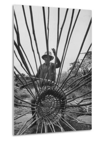 Man Making a New Trap For Fishing-Dmitri Kessel-Metal Print