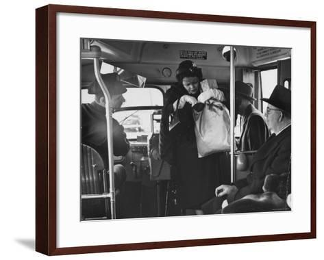 Lady Searching For 2 Cents For Her Bus Fair-Nina Leen-Framed Art Print