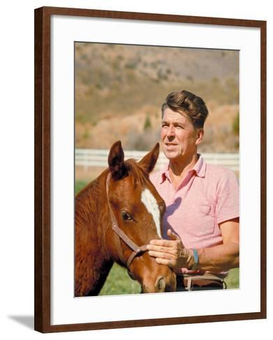 California Governor Candidate Ronald Reagan Petting Horse at Home on Ranch-Bill Ray-Framed Art Print