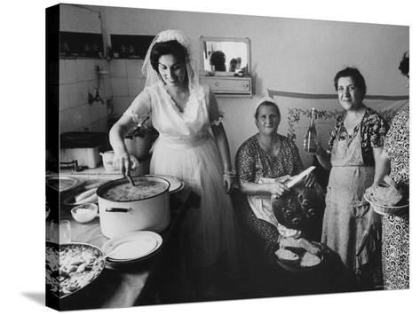 Bride Assisting in Kitchen During Wedding-Paul Schutzer-Stretched Canvas Print