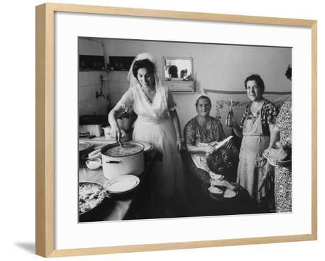 Bride Assisting in Kitchen During Wedding-Paul Schutzer-Framed Art Print