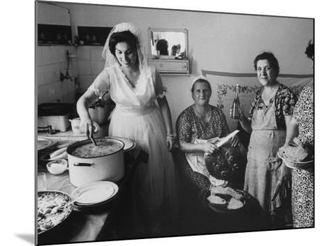 Bride Assisting in Kitchen During Wedding-Paul Schutzer-Mounted Photographic Print