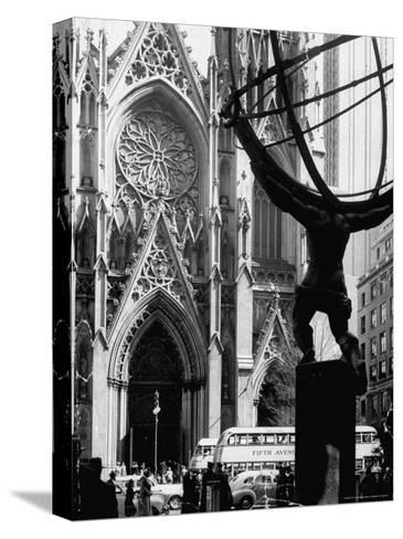 Entrance to St. Patrick's Visible Across Fifth Avenue, with Atlas Statue Silhouetted in Foreground-Andreas Feininger-Stretched Canvas Print