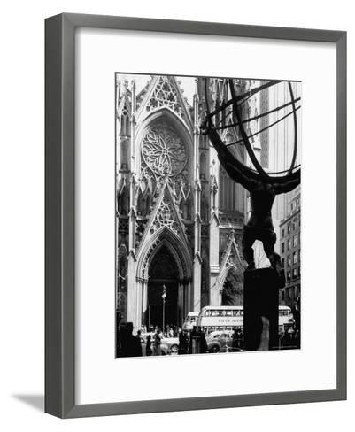 Entrance to St. Patrick's Visible Across Fifth Avenue, with Atlas Statue Silhouetted in Foreground-Andreas Feininger-Framed Art Print