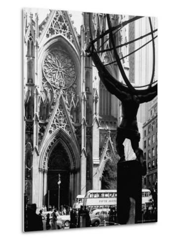 Entrance to St. Patrick's Visible Across Fifth Avenue, with Atlas Statue Silhouetted in Foreground-Andreas Feininger-Metal Print