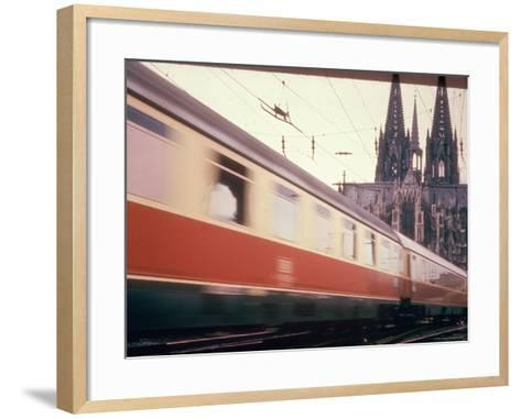 Eurailpass in Europe: Germany's Parsifal Express Speeding Past Cologne Cathedral-Carlo Bavagnoli-Framed Art Print