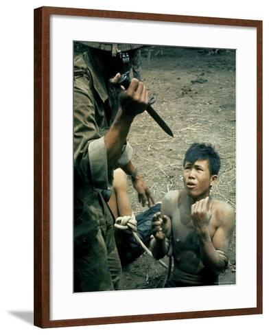 Bayonet Wielding South Vietnamese Soldier Menacing Captured Viet Cong Suspect During Interrogation-Larry Burrows-Framed Art Print