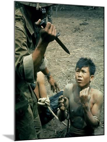 Bayonet Wielding South Vietnamese Soldier Menacing Captured Viet Cong Suspect During Interrogation-Larry Burrows-Mounted Photographic Print