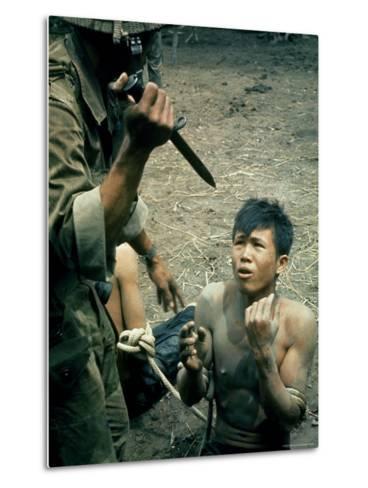 Bayonet Wielding South Vietnamese Soldier Menacing Captured Viet Cong Suspect During Interrogation-Larry Burrows-Metal Print