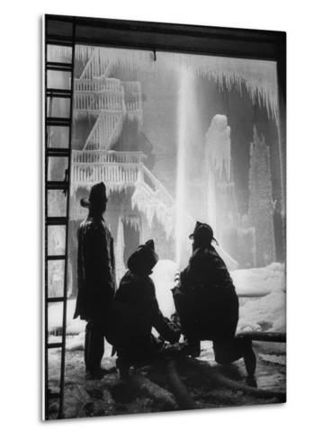 Firemen Fighting a Fire During Icy Weather-Al Fenn-Metal Print