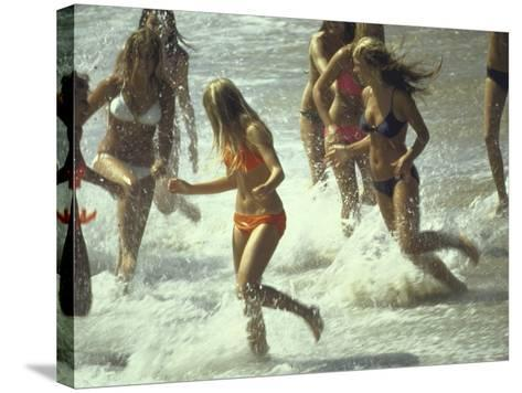 Bikini Clad Teens Frolicking in Surf at Beach-Co Rentmeester-Stretched Canvas Print