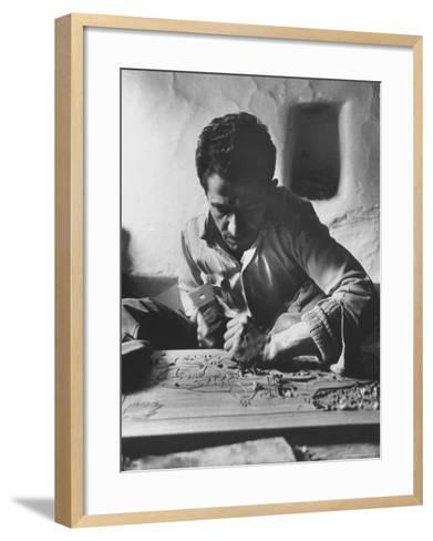 Greek Mountain Villager Engaged in Woodworking During the Winter-James Burke-Framed Art Print