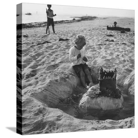 Kid Playing in Sand-Martha Holmes-Stretched Canvas Print