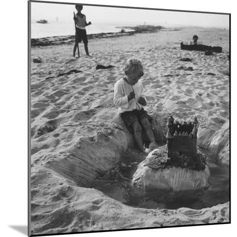 Kid Playing in Sand-Martha Holmes-Mounted Photographic Print