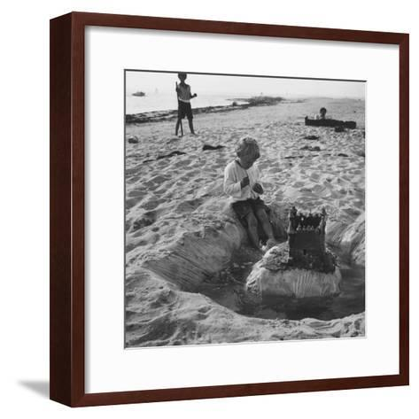 Kid Playing in Sand-Martha Holmes-Framed Art Print