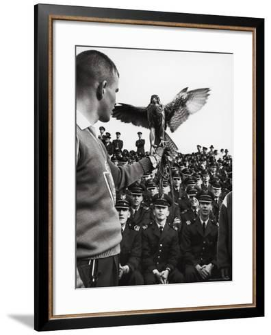 Air Force Academy Cadets Watching Handler Performing with the Air Force Mascot, a Falcon-Leonard Mccombe-Framed Art Print