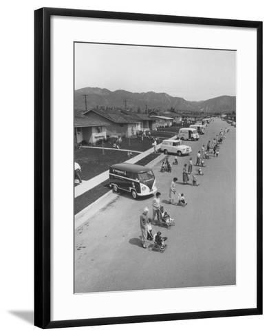 Diaper Service Trucks and Mothers with Babies They Service Line Street-Ralph Crane-Framed Art Print