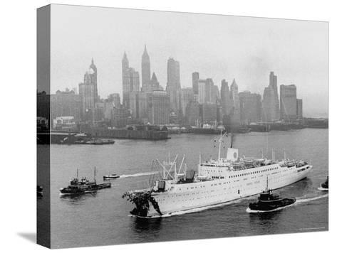 Aerial View of MS Stockholm Entering Harbor After Crash with SS Andrea Doria Against Skyline-Howard Sochurek-Stretched Canvas Print