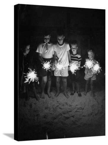 Children Holding Sparklers on a Beach-Lisa Larsen-Stretched Canvas Print