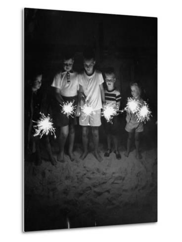 Children Holding Sparklers on a Beach-Lisa Larsen-Metal Print