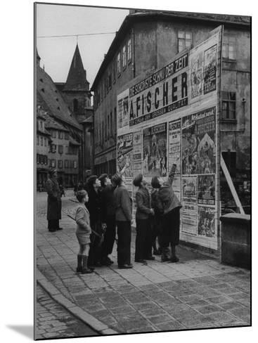 Boys Examining Circus Posters-Carl Mydans-Mounted Photographic Print