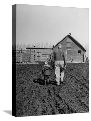Grandpa and 4 Year Old Granddaughter, on Morning Chores, to Feed Pigs on Nearby Lot-Gordon Parks-Stretched Canvas Print