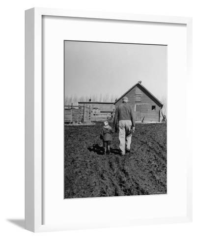Grandpa and 4 Year Old Granddaughter, on Morning Chores, to Feed Pigs on Nearby Lot-Gordon Parks-Framed Art Print