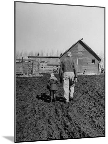 Grandpa and 4 Year Old Granddaughter, on Morning Chores, to Feed Pigs on Nearby Lot-Gordon Parks-Mounted Photographic Print