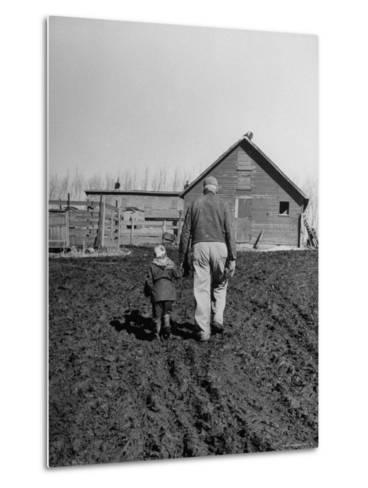 Grandpa and 4 Year Old Granddaughter, on Morning Chores, to Feed Pigs on Nearby Lot-Gordon Parks-Metal Print