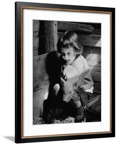 Jan Bruene with Piglet of a Group 2-3 Weeks Old, Kept in Basement of Home-Gordon Parks-Framed Art Print