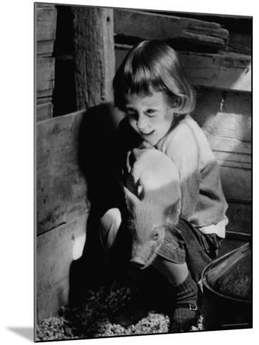 Jan Bruene with Piglet of a Group 2-3 Weeks Old, Kept in Basement of Home-Gordon Parks-Mounted Photographic Print
