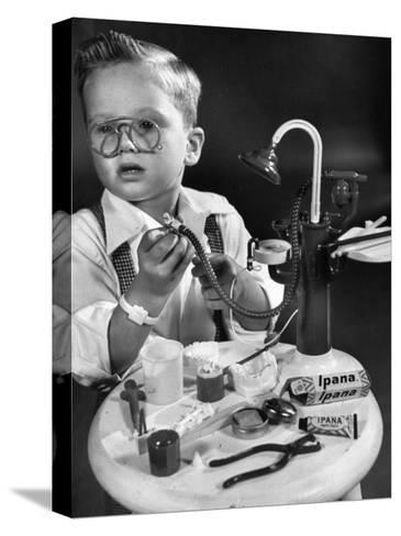 Little Boy with a Toy Dentist Set-Walter Sanders-Stretched Canvas Print