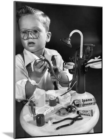 Little Boy with a Toy Dentist Set-Walter Sanders-Mounted Photographic Print