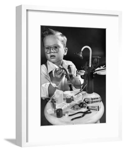 Little Boy with a Toy Dentist Set-Walter Sanders-Framed Art Print