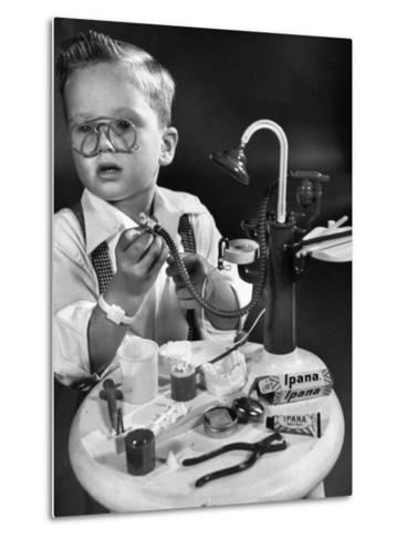 Little Boy with a Toy Dentist Set-Walter Sanders-Metal Print