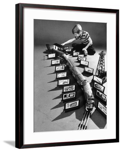 Little Boy Playing with a Toy Train and Billboard Set-Walter Sanders-Framed Art Print