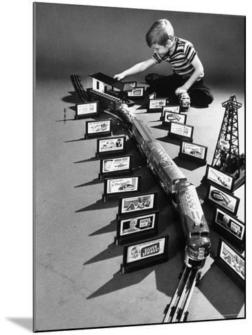Little Boy Playing with a Toy Train and Billboard Set-Walter Sanders-Mounted Photographic Print